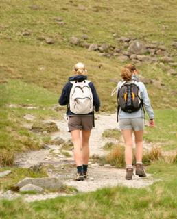 walkers walking in hills