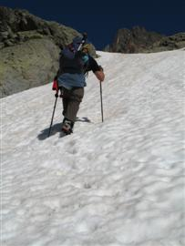Using two trekking poles for extra purchase of difficult terrain such as walking up a snow slope