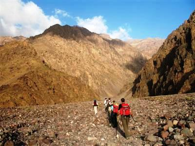 Leaving lac d'ifni Toubkal mountains High Atlas Morocco guided trekking holiday and tour