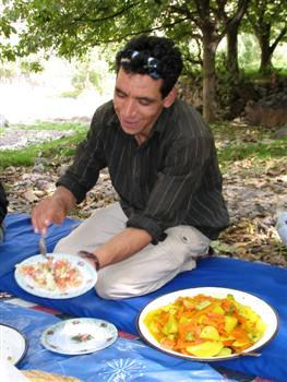 serving lunch jbel toubkal mountain trek high atlas morocco guided trekking and walking holidays and tours