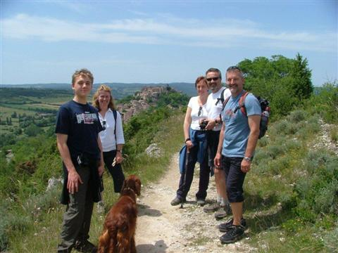 picture of walkers approaching cordes sur ciel in midi pyrenees - self catering independent walking holiday in Tarn