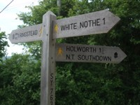 white nothe signpost