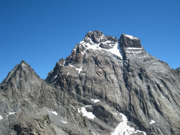 Alpine peak bagging trekking holiday passes close to mountain of Mont Viso in Italy